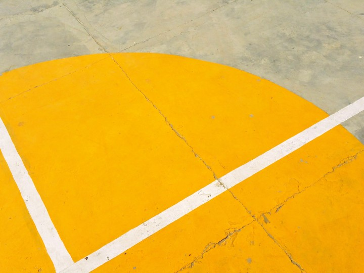 gray-concrete-pavement-with-yellow-and-white-paint-273786